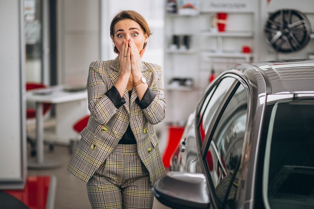 Woman in a car showroom