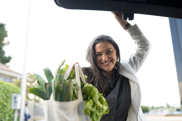 Woman in car trunk with purchase