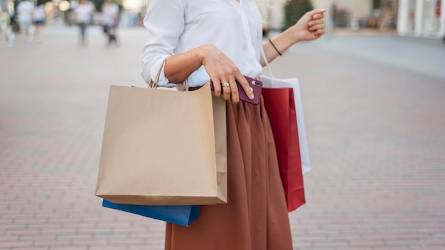 Woman carrying colourful shopping bbags