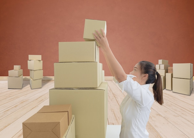 Woman carrying and lifting boxes