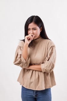 Woman catching a cold, flu, runny nose, allergy