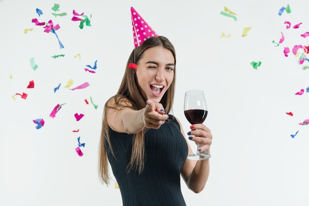 Woman at celebration party with a glass of wine