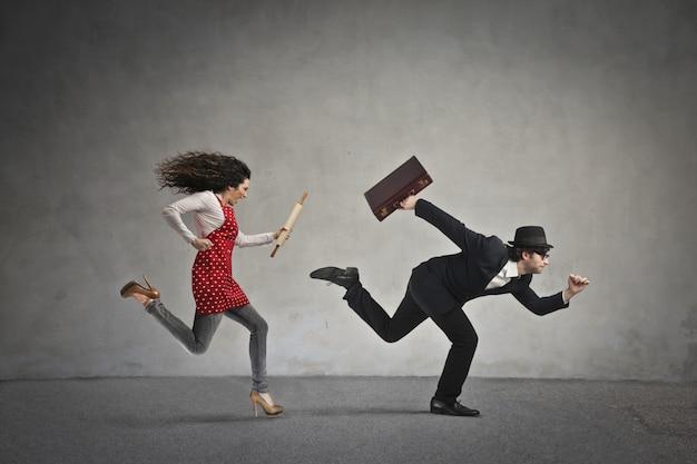 Woman chasing a man