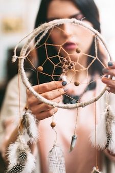 Woman checking finished dreamcatcher