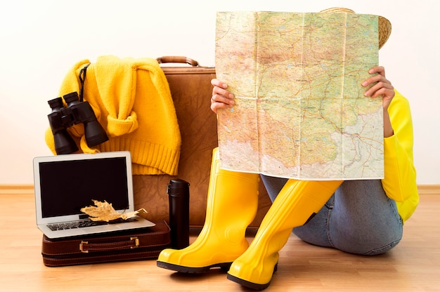 Woman checking a map for an autumn travel destination