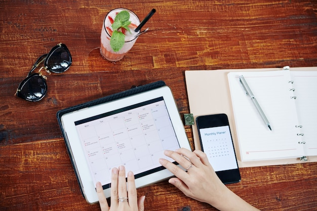 Woman checking planner app