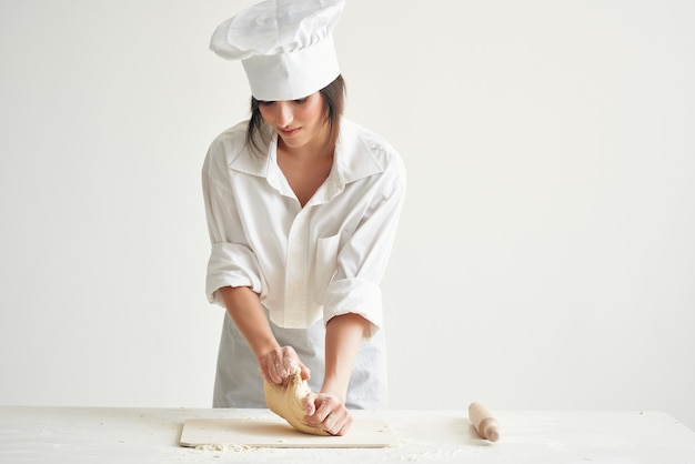 Woman chef rolls out dough bakery cooking pastry