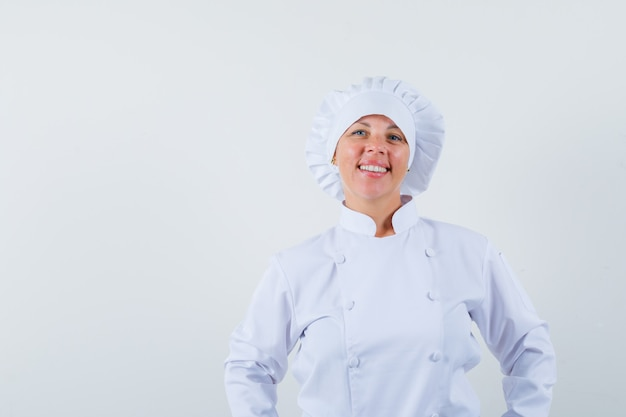 Woman chef in white uniform looking at front and looking confident