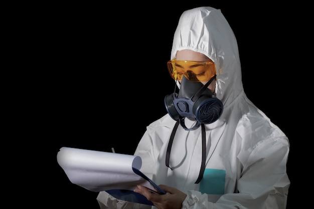 Woman in chemical protective clothing and antigas mask with glasses at white background, women scientist in safety suit, safety virus infection concept