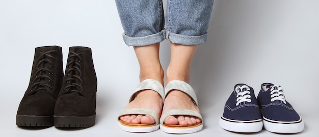 Woman chooses sandals among other
