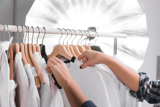 Woman choosing clothes for a photo shooting