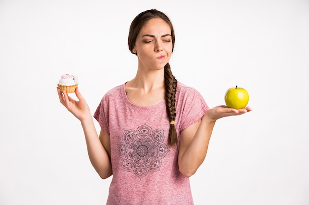 Woman choosing fast or healthy food