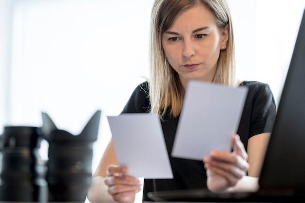 Woman choosing between multiple photos