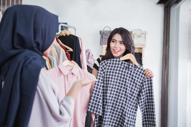 Woman choosing a new shirt