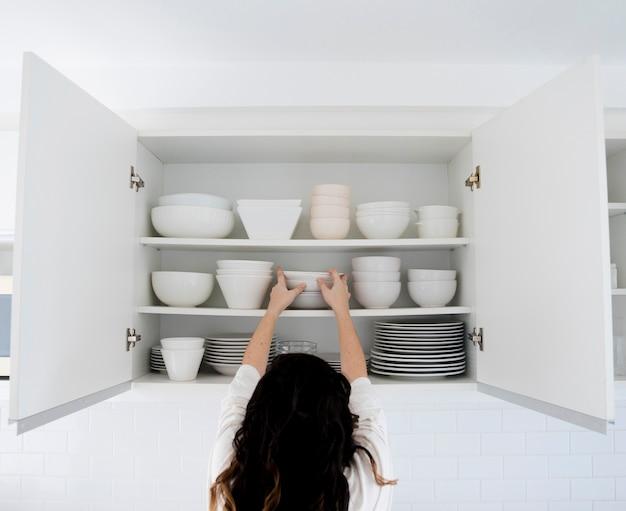 Woman choosing plates