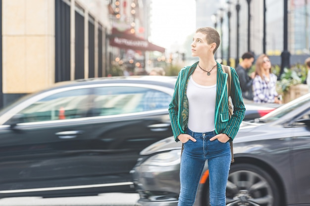 Woman in the city with blurred cars