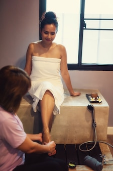 Woman clean and wash feet in spa
