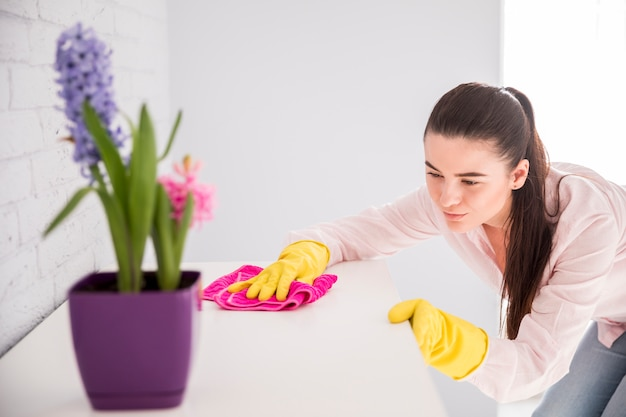 Woman cleaning her home