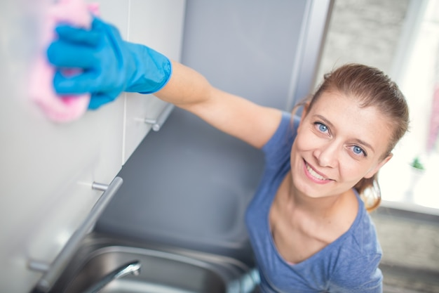 Woman cleaning in the kitchen at home