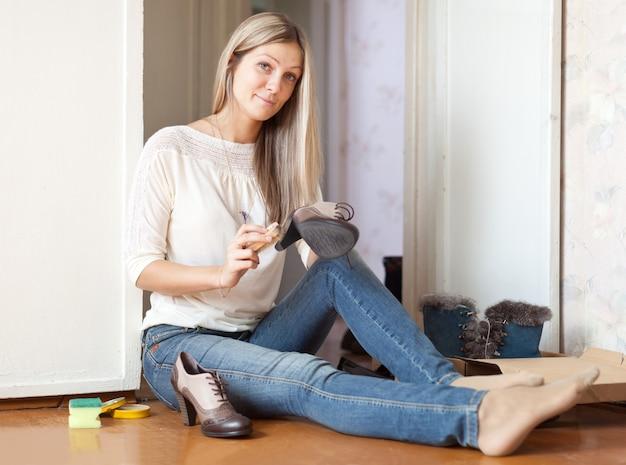 Woman cleans footwear