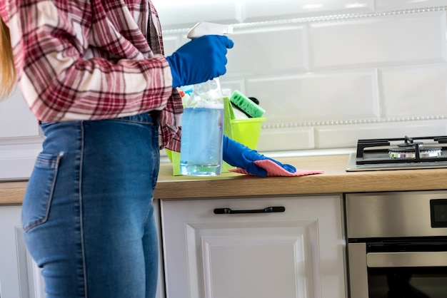 Woman cleans in the kitchen. concept of cleanliness