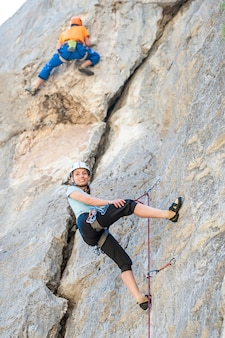 The woman climber resting while overcoming challenging trails