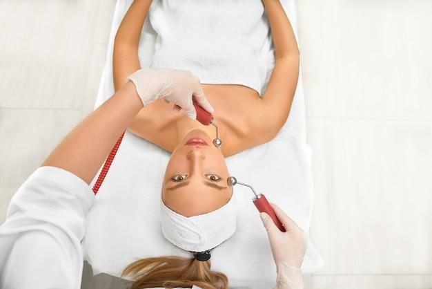 Woman close up receiving electric facial massage