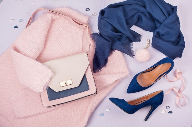 Woman clothing and accessories in pastel colors.