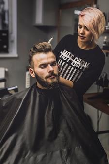 Woman combing stylish man