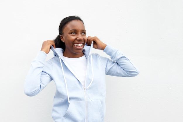 Woman in comfortable hoodie looking up laughing