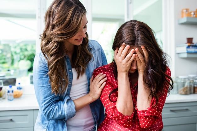 Woman comforting worried friend