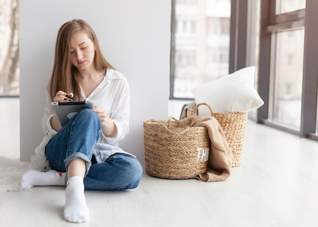 Woman coming up with new ideas for a blog indoors with copy space