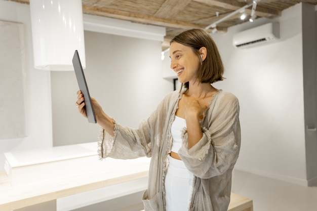Woman communicate by phone at home