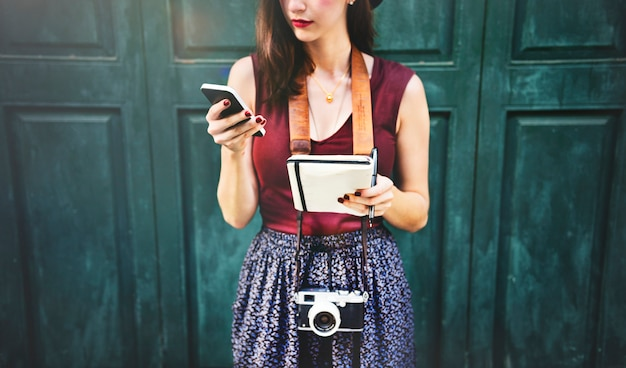 Woman communicate phone outside city concept