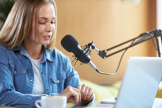 Woman communicating online with people in microphone