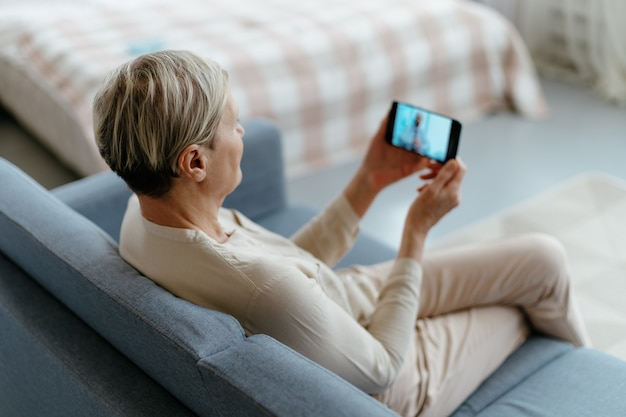 Woman communicating with her home doctor in a video chat