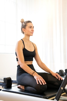 Woman concentrating before pilates exercise at gym
