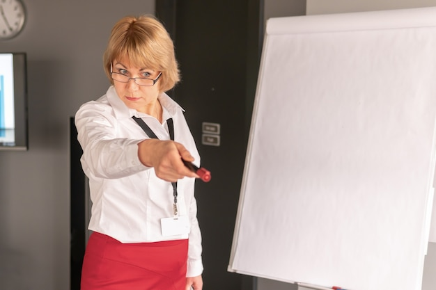 A woman conducts training in a business center