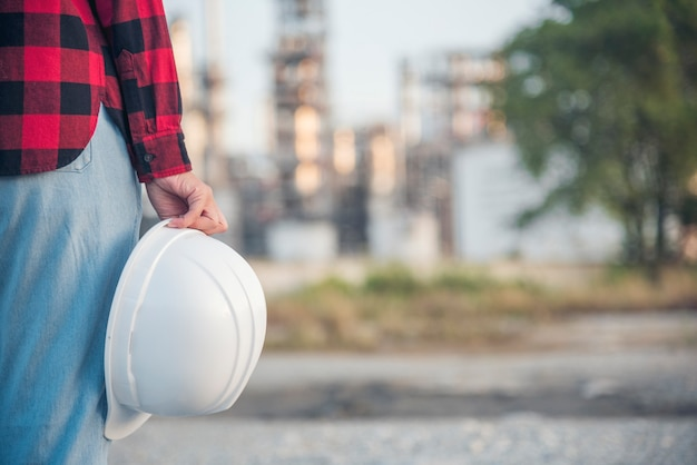 Woman construction engineer wear safety white hard hat at construction site industry worker