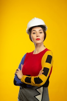 Woman in construction helmet poses on camera