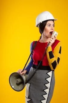 Woman in construction helmet with speaker