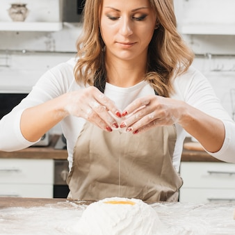 Woman cooking cake