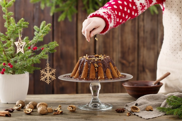 Woman cooking christmas cake on wood kitchen