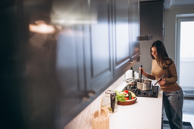 Woman cooking at kitchen