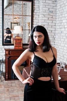 Woman in a corset. interior