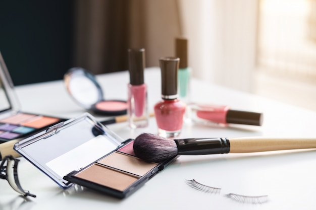 Woman cosmetics, brush and make up on dressing table at home