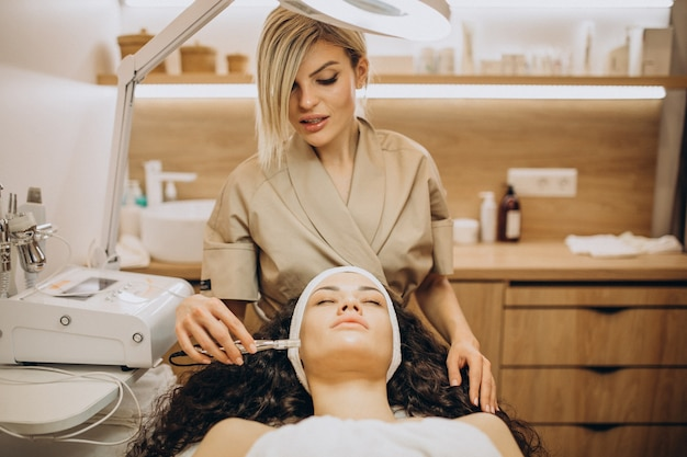 Woman at cosmetologist making beauty procedures