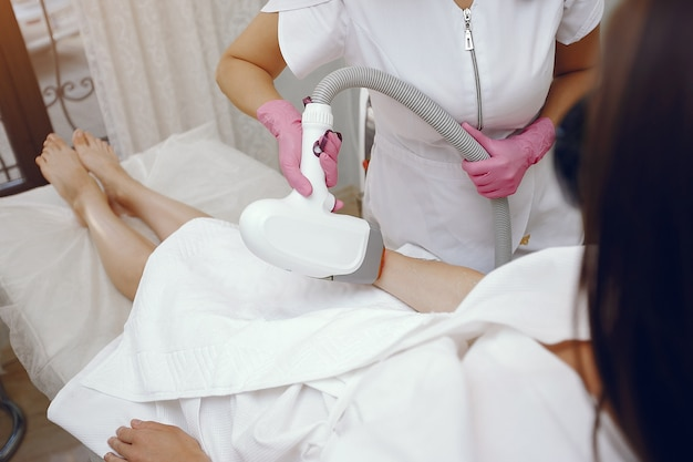 Woman in cosmetology studio on laser hair removal
