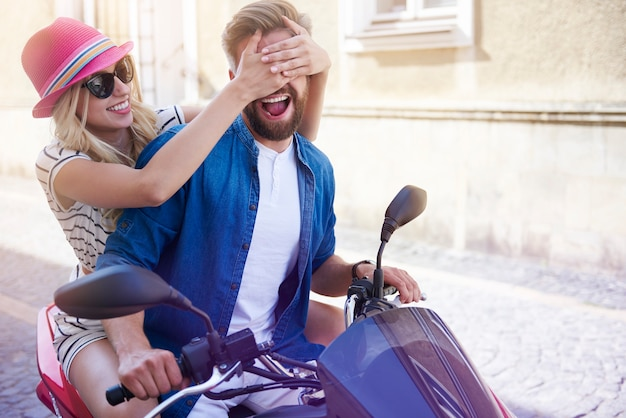 Woman covering eyes of her boyfriend