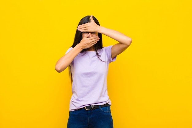 Woman covering face with both hands